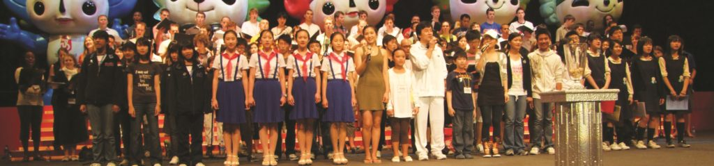 WYC performing with Jackie Chan at the Opening ceremonies of the Olympic Equestrian Games in Hong Kong - Jean-Claude Wilkens © Foundation World Youth Choir