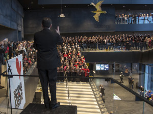 Ben Parry leading the choirs singing in Harpa Music Hall