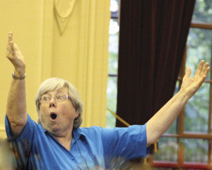 The inimitable Judy Clingan conducts the massed antiphonal choirs in Hassler