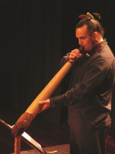 Horomona Horo, Taonga Puoro Artists at WSCM9 playing the pkea (wooden trumpet)