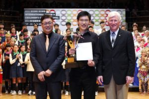 "Prof. Leon Shiu-wai TONG and Dr. Michael J. ANDERSON present the ""Choir of the World"" award"